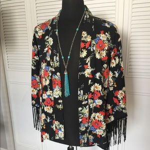 Floral print shawl with fringe.